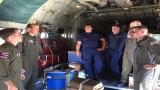 Coast Guard HC-130 Hercules airplane crew conducts pre-flight brief