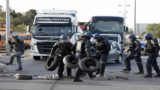 French gendarmes remove tyres and branches after striking workers blockaded roads near the oil terminal at Fos-sur-Mer, near Marseille, France, May 24, 2016 with France's hardline CGT and FO unions toughening their stance against labour market reforms.  REUTERS/Jean-Paul Pelissier